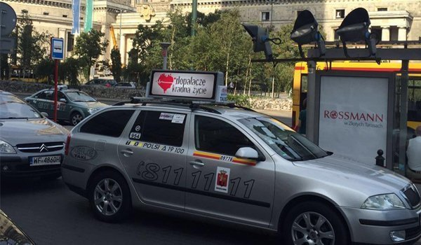 Taxi top advertising sign